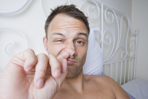 Man in Bed Picking His Nose
