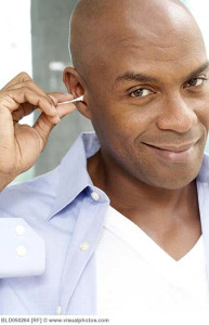 african_american_man_cleaning_ear_with_cotton_swab_bld050264