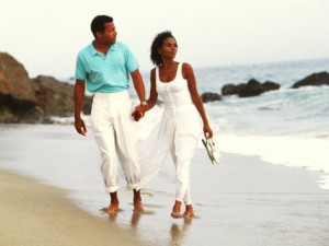 bill-bachmann-black-couple-walking-together-on-the-beach
