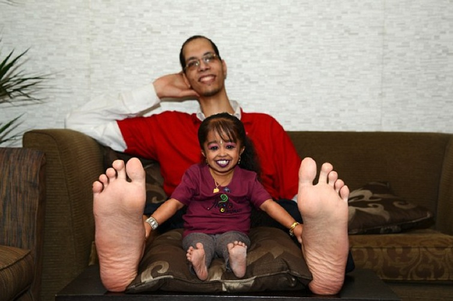 Here she is with the man with the World's Biggest Feet.