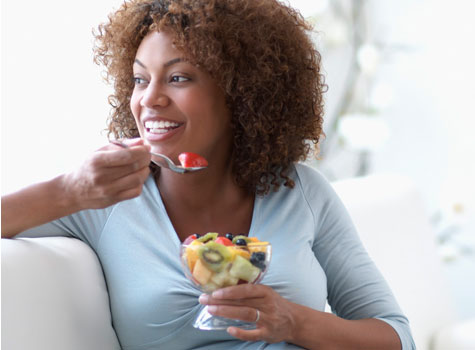 black-woman-eating-fruit-475x350