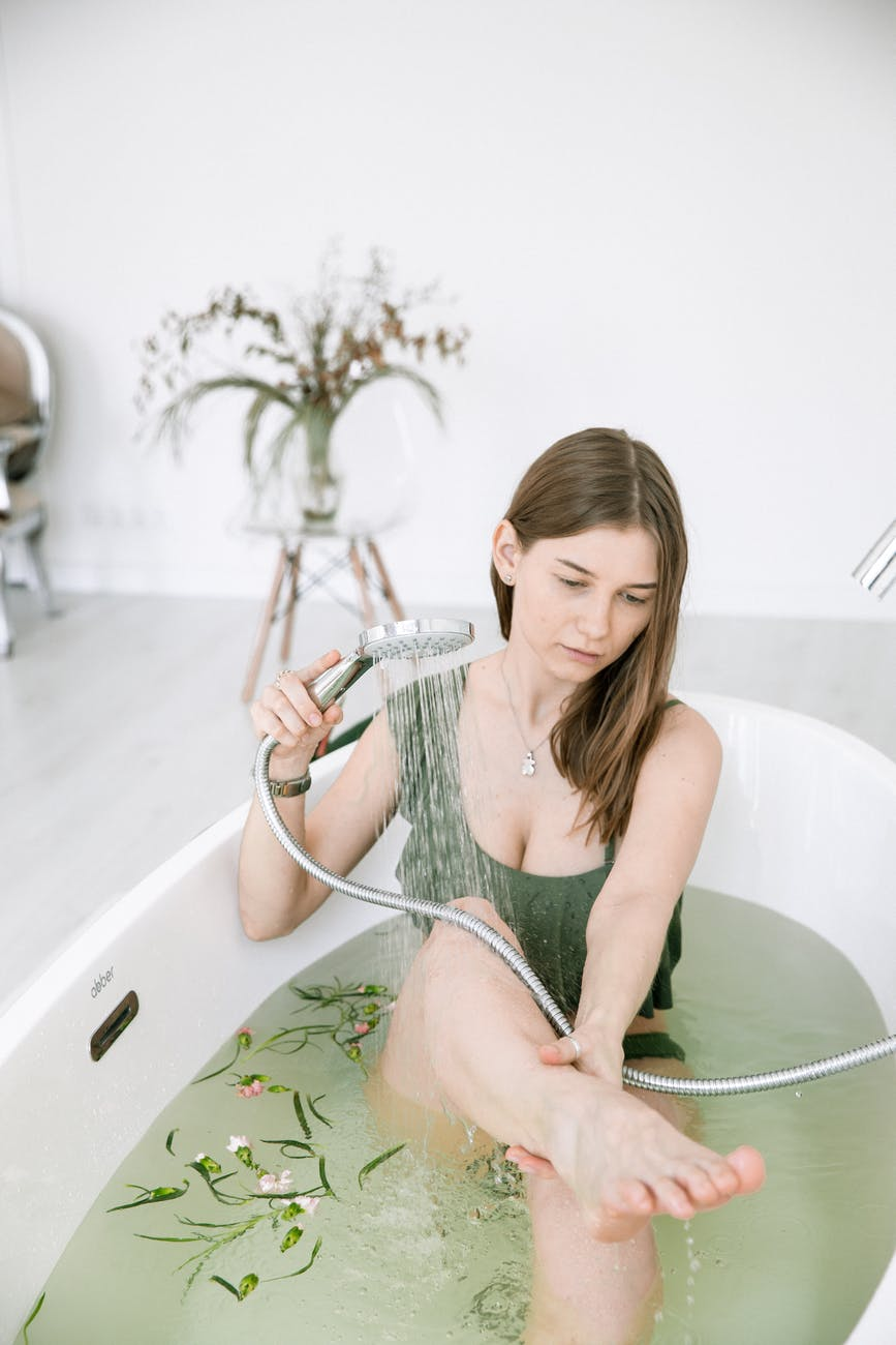 photo of woman cleaning herself